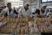 Butchers present their meat at the Dorogomilovsky Market during a 'slow food' farmers' festival in Moscow on September 25 2010 AFP PHOTO / Alexey...