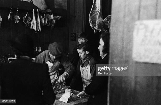 A butcher's shop in Liverpool circa 1940 Original Publication Picture Post 356 Liverpool unpub