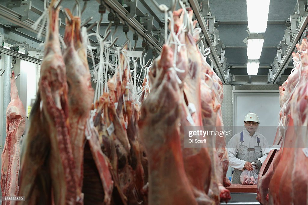 Butchers working for 'G. Lawrence Wholesale Meat' prepare meat for sale in Smithfield Market on March 14, 2013 in London, England. Smithfield Market, which is officially named the 'London Central Markets', has been the site of a livestock market since the Twelfth Century. Located in the City of London, the market's Victorian buildings were designed by Sir Horace Jones, the City Architect, and were completed in the 1860s. Developers have recently proposed a 160 million GBP refurbishment of the derelict western end of Smithfield Market into an artisan food centre known as 'Smithfield Quarter'.