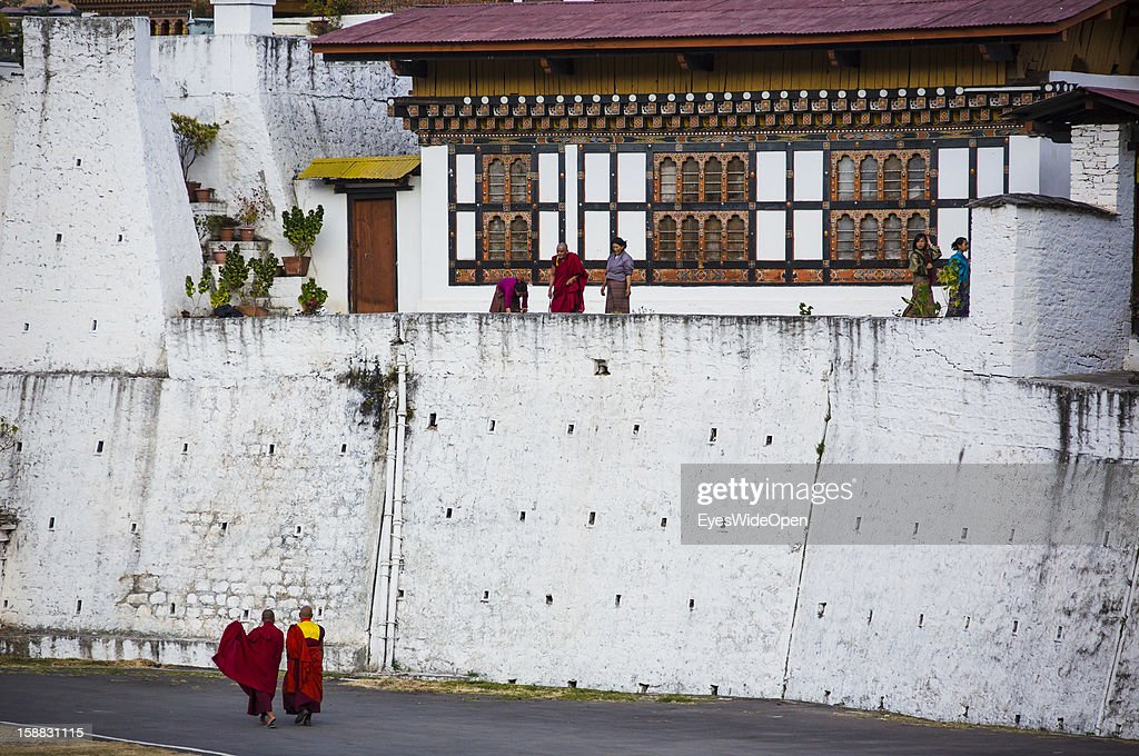 Buthanese buddhist monks at the Majestic Monastery-fortress, the Palace of Great Happiness in Punakha, the country's old capital, which is about two hours away from Thimphu on November 18, 2012 in Punakha, Bhutan. The Punakha Dzong, is the administrative centre of Punakha dzongkhag. Constructed by Zhabdrung (Shabdrung) Ngawang Namgyal in 1637-38