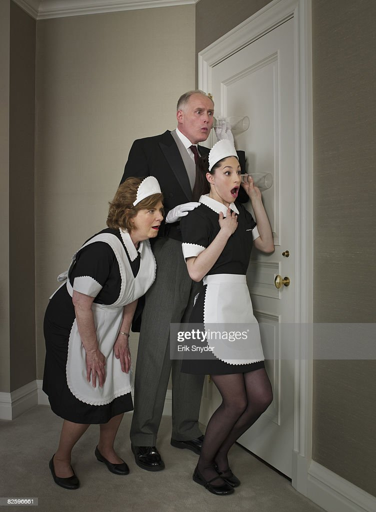 Butler and maids spying on tenants : Stock Photo