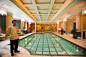 Butler at pool, Emperor Suite, The Empire Hotel and Country Club, Brunei Darussalam.