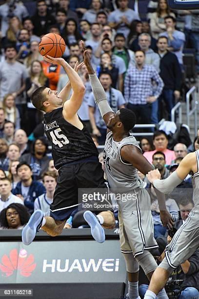 Butler Bulldogs forward Andrew Chrabascz scores in the second half over Georgetown Hoyas forward Marcus Derrickson on January 7 at the Verizon Center...