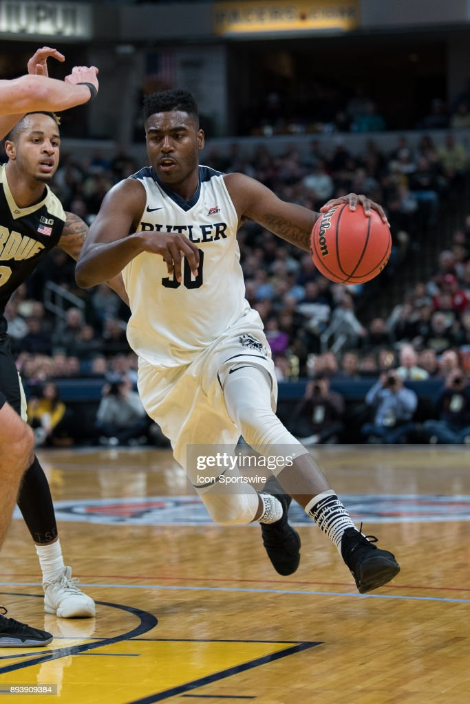 Butler Bulldogs forward Kelan Martin (30) drives to the basket during the Crossroads Classic basketball game between the Butler Bulldogs and Purdue Boilermakers on December 16, 2017, at Bankers Life Fieldhouse in Indianapolis, IN.