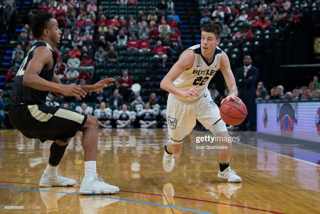 Butler Bulldogs forward Sean McDermott (22) drives on the perimeter against Purdue Boilermakers forward Vincent Edwards (12) during the Crossroads Classic basketball game between the Butler Bulldogs and Purdue Boilermakers on December 16, 2017, at Bankers Life Fieldhouse in Indianapolis, IN.