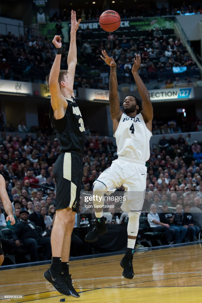 Butler Bulldogs forward Tyler Wideman (4) shoots over Purdue Boilermakers forward Matt Haarms (32) during the Crossroads Classic basketball game between the Butler Bulldogs and Purdue Boilermakers on December 16, 2017, at Bankers Life Fieldhouse in Indianapolis, IN.