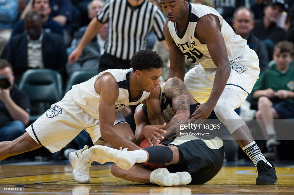 Butler Bulldogs guard Aaron Thompson (2) and Purdue Boilermakers forward Vincent Edwards (12) battle for a loose ball during the Crossroads Classic basketball game between the Butler Bulldogs and Purdue Boilermakers on December 16, 2017, at Bankers Life Fieldhouse in Indianapolis, IN.