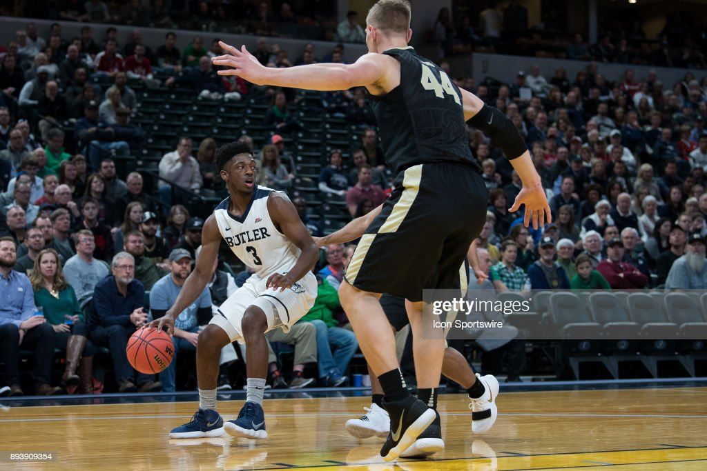 Butler Bulldogs guard Kamar Baldwin (3) drives baseline against Purdue Boilermakers center Isaac Haas (44) during the Crossroads Classic basketball game between the Butler Bulldogs and Purdue Boilermakers on December 16, 2017, at Bankers Life Fieldhouse in Indianapolis, IN.