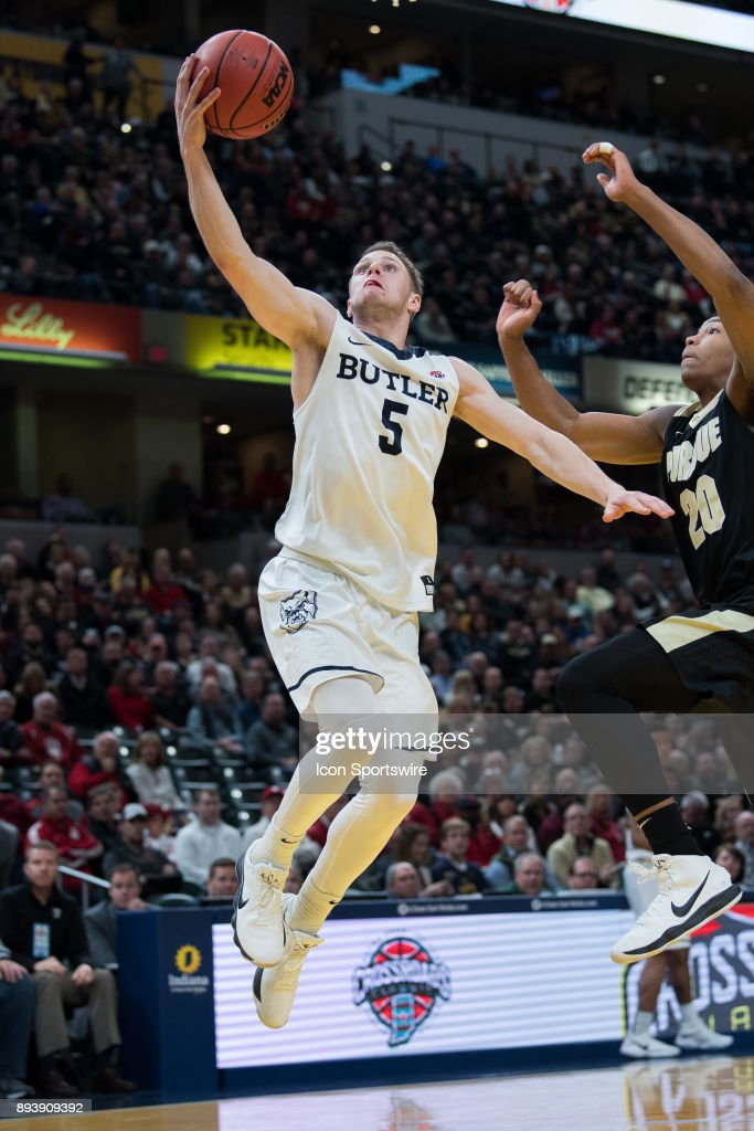 Butler Bulldogs guard Paul Jorgensen (5) scores on a fast break during the Crossroads Classic basketball game between the Butler Bulldogs and Purdue Boilermakers on December 16, 2017, at Bankers Life Fieldhouse in Indianapolis, IN.