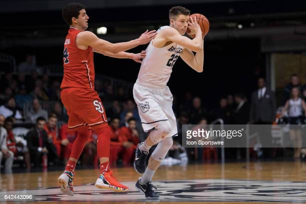 Butler Bulldogs guard Sean McDermott brings the ball up the court against St John's Red Storm guard Federico Mussini during the men's college...