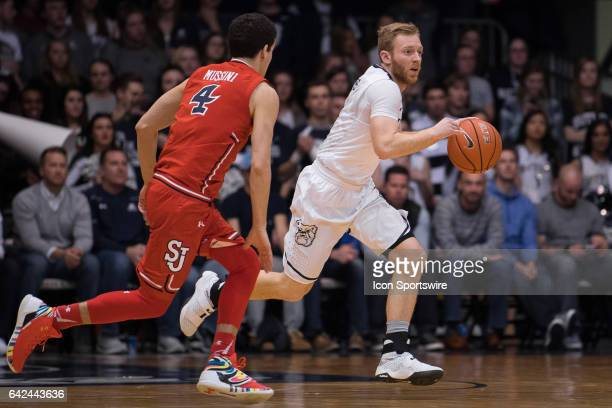 Butler Bulldogs guard Tyler Lewis brings the ball up against St John's Red Storm guard Federico Mussini during the men's college basketball game...