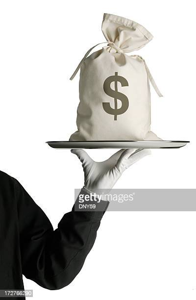 Butler carrying money bag on silver serving tray