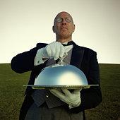Butler carrying silver platter (Digital Enhancement)