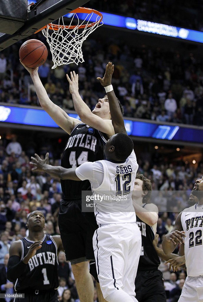 Butler center Andrew Smith puts up a goahead score against Pittsburgh guard Ashton Gibbs with only seconds remaining in a thirdround game of the 2011...