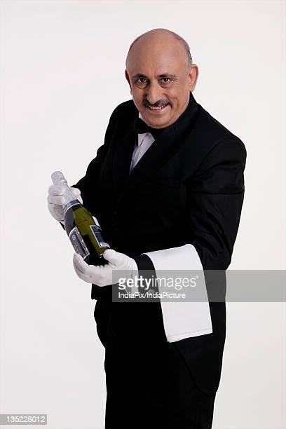 Butler holding a bottle