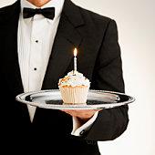 Butler holding cupcake