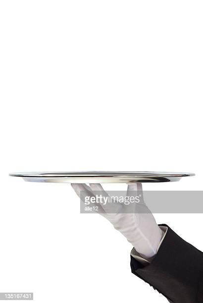 Butler holding empty silver tray in gloved hand