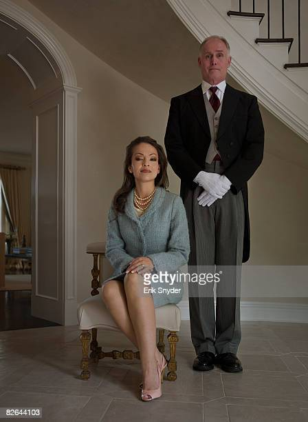 Butler posed with wealthy home owner.