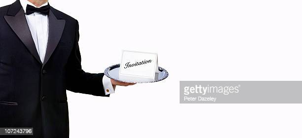 Butler waiter with invitation on serving tray