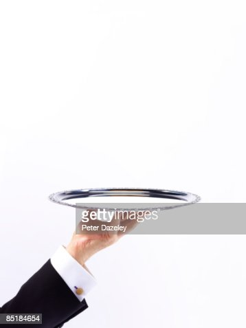 Butler Waiter with silver tray against white