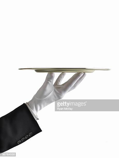 butler's hand presenting a silver platter