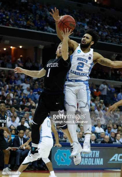 Butler's Tyler Lewis shoots as North Carolina's Joel Berry II defends during the first half in the NCAA Tournament South Regional semifinal at...