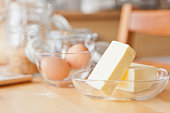 Butter and eggs on wooden table