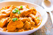 Traditional Indian Chicken Curry Dish Served in a Bowl.