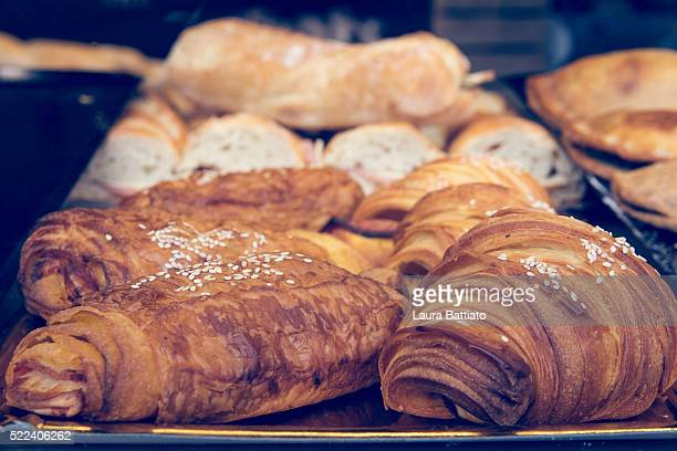 Butter croissant pastry and sandwiches on a tray