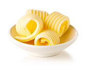 Bowl of butter curls isolated on white background