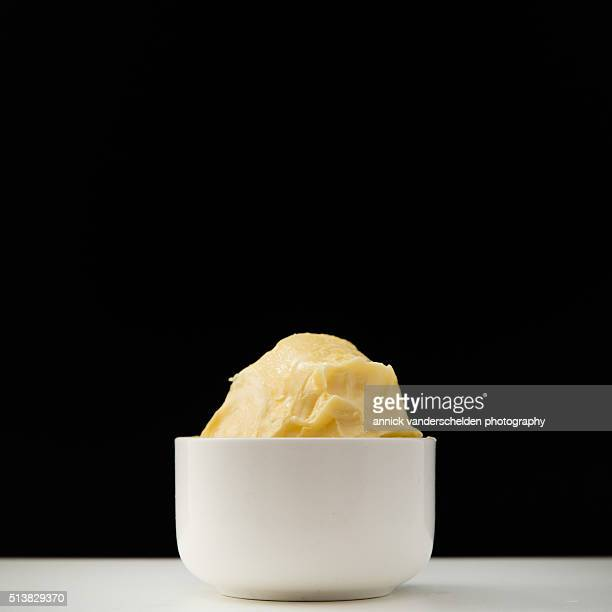 Butter in white cup.