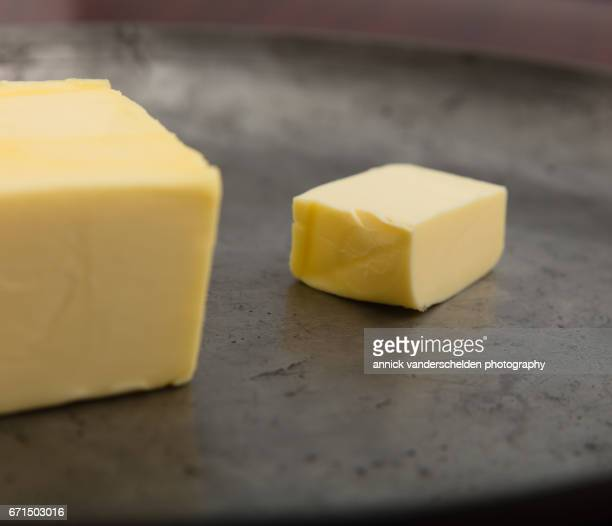 Butter on pewter plate.