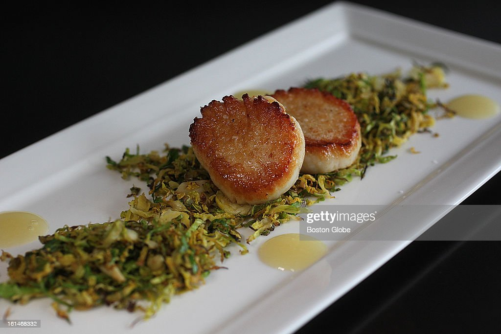 Butter poached local dayboat scallops with shaved dry roasted brussels sprouts at the Waban Kitchen.