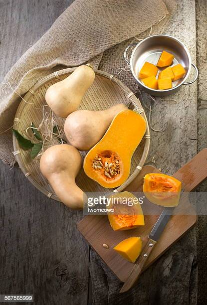Butter squash cut open on wooden table top