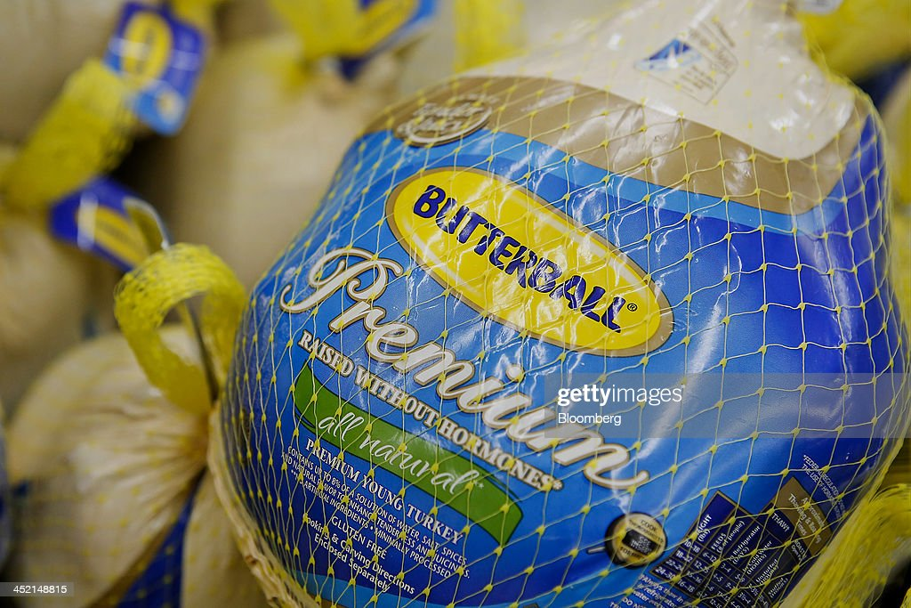 Butterball frozen turkeys are displayed for sale at a Wal-Mart Stores Inc. location ahead of Black Friday in Los Angeles, California, U.S., on Tuesday, Nov. 26, 2013. Wal-Mart Stores Inc. said Doug McMillon, head of its international business, will replace Mike Duke as chief executive officer when he retires as the world's largest retailer struggles to ignite growth at home and abroad. Photographer: Patrick T. Fallon/Bloomberg via Getty Images