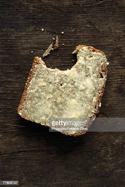 Buttered bread with bite missing
