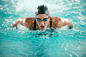 High speed action shot of a butterfly stroke swimming champion