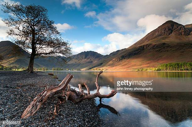Buttermere water with stunning reflections of the Cumbrian mountains, Lake District. England. UK