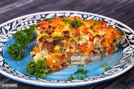 Butternut squash and sausage frittata. : Stock Photo