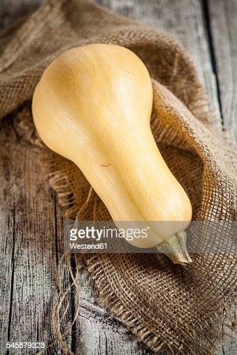 Butternut squash, Cucurbita moschata, on burlap