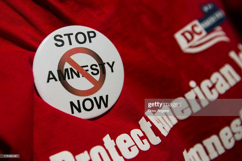 A button on a shirt is seen during the DC March for Jobs in Upper Senate Park near Capitol Hill, on July 15, 2013 in Washington, DC. Conservative activists and supporters rallied against the Senate's immigration legislation and the impact illegal immigration has on reduced wages and employment opportunities for some Americans.
