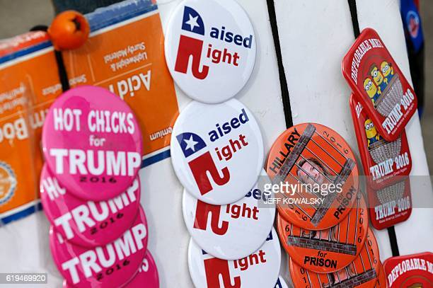 Buttons are being sold to people waiting to see US Republican presidential nominee Donald Trump speak at Macomb Community College on October 31 2016...