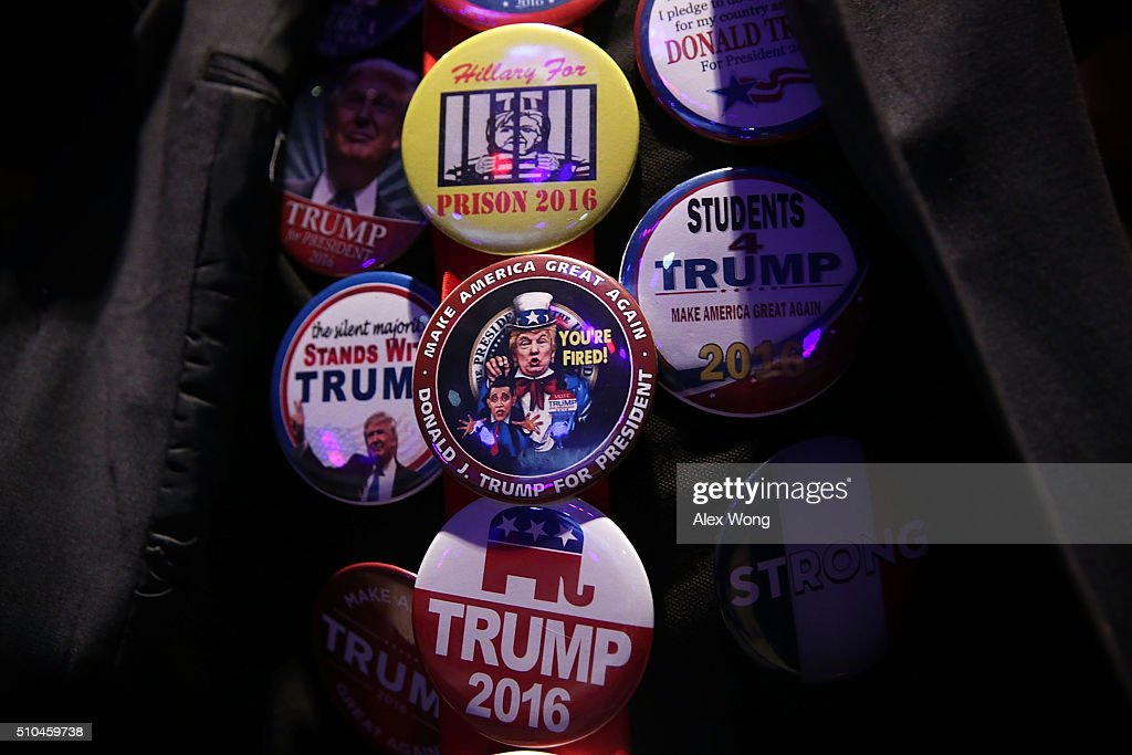 Buttons featuring Republican presidential candidate Donald Trump are seen on a supporter during a campaign event February 15 2016 in Greenville South...