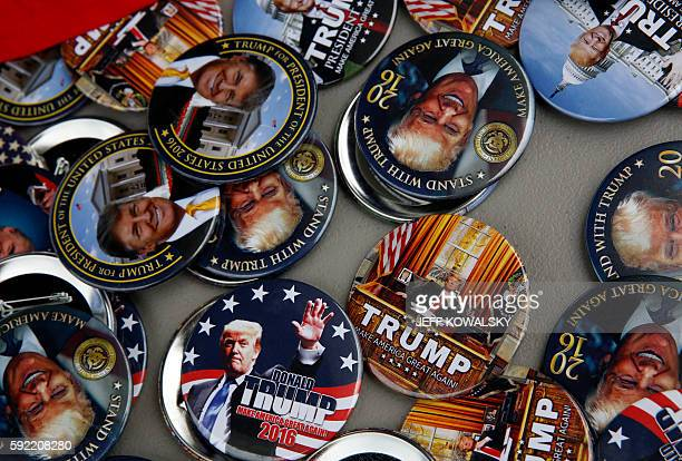 Buttons for sale for US Republican presidential candidate Donald Trump are seen outside his rally at the Summit Sports and Ice Complex on August 19...