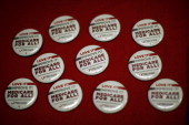 Buttons promoting Medicare for all ages are seen as nurses and physicians give free basic health screenings and call attention to what they say is...