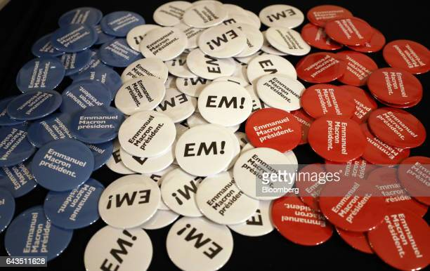 Buttons sit on a desk before Emmanuel Macron French presidential candidate not pictured speaks at a campaign meeting with French expatriates at...