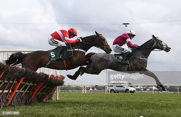 Buveur D'Air ridden by Noel Fehily jumps the last fence behind Petit Mouchoir ridden by David Mullins during their victory in the Imagine Cruising...