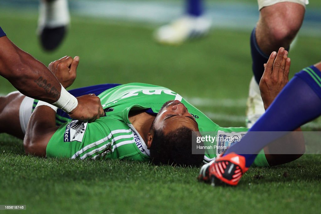 Buxton Popoalii of the Highlanders lies unconscious after being hit high during the round eight Super Rugby match between the Blues and the Highlanders at Eden Park on April 5, 2013 in Auckland, New Zealand.