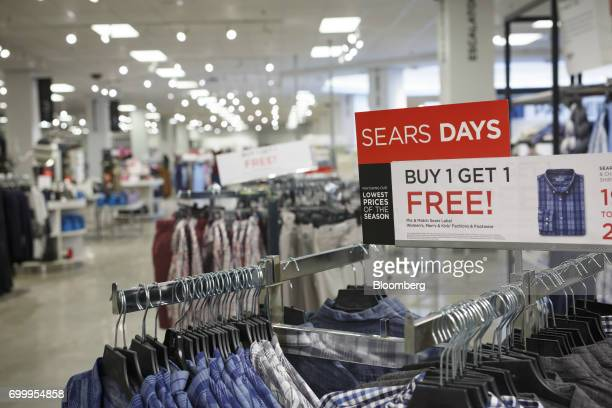 A 'Buy 1 Get 1 Free' sign is displayed at a Sears Canada Inc store inside a mall in Toronto Ontario Canada on Thursday June 22 2017 Canadian retailer...