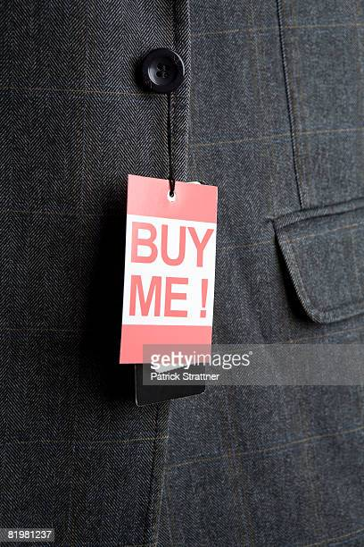 ?Buy Me!? price tag hanging from a sport jacket button
